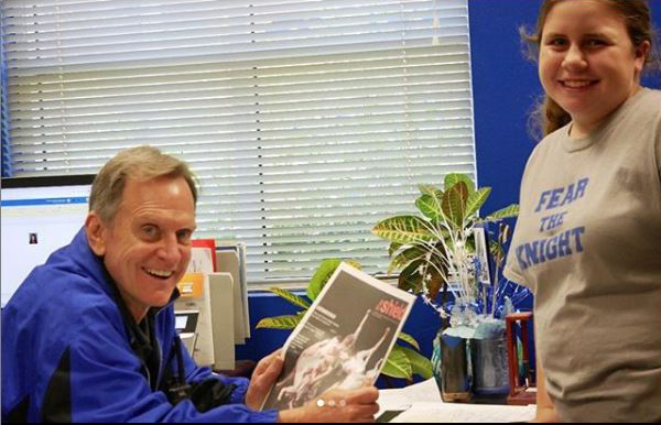 Over his long tenure as the McCallum principal, Mike Garrison, shown here receiving the most recent edition of The Shield from first-year staff member Elisha Scott, has  consistently supported the publication's freedom of expression and freedom from prior review. Last year, he earned our praise by allowing the same freedom of expression to the varsity cheerleaders who chose to kneel during the national anthem at football games. The district likewise stated that the students were exercising their free speech.