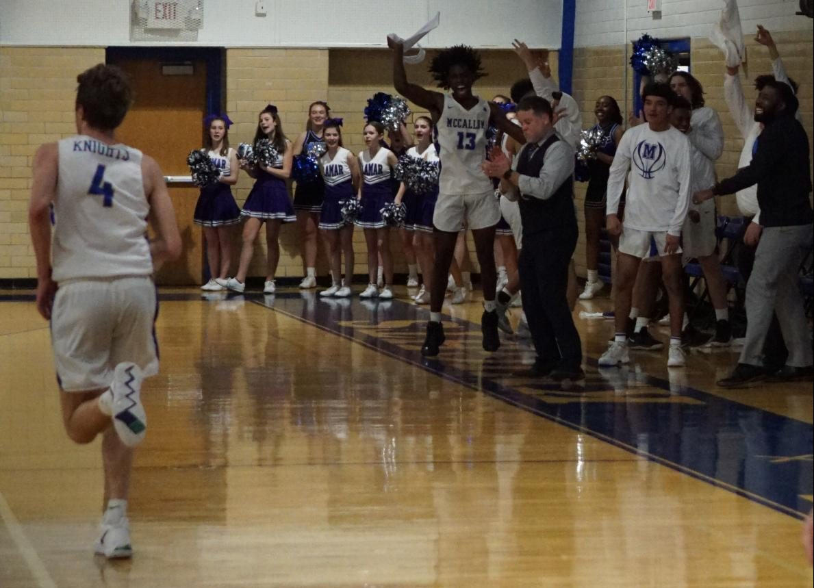 As the Knight bench erupts after another of his 3-pointers, Sam Werkenthin trots back to play defense. Werkenthin scored 20 points and shot six of eight from downtown as Mac rolled to a key victory over Reagan that left the teams tied for third place.