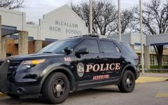 An AISD police car was parked outside of the front entrance of McCallum on Feb. 14 after terroristic threats from the previous days. AISD police sent extra officers to campus on Valentine's Day