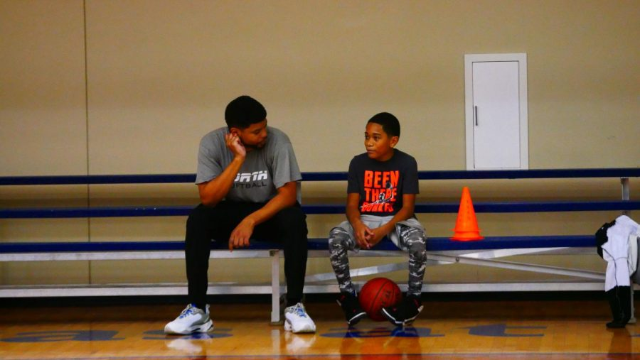 With todays games over, father and son share some rest and conversation before departing the Maverick Activities Center.