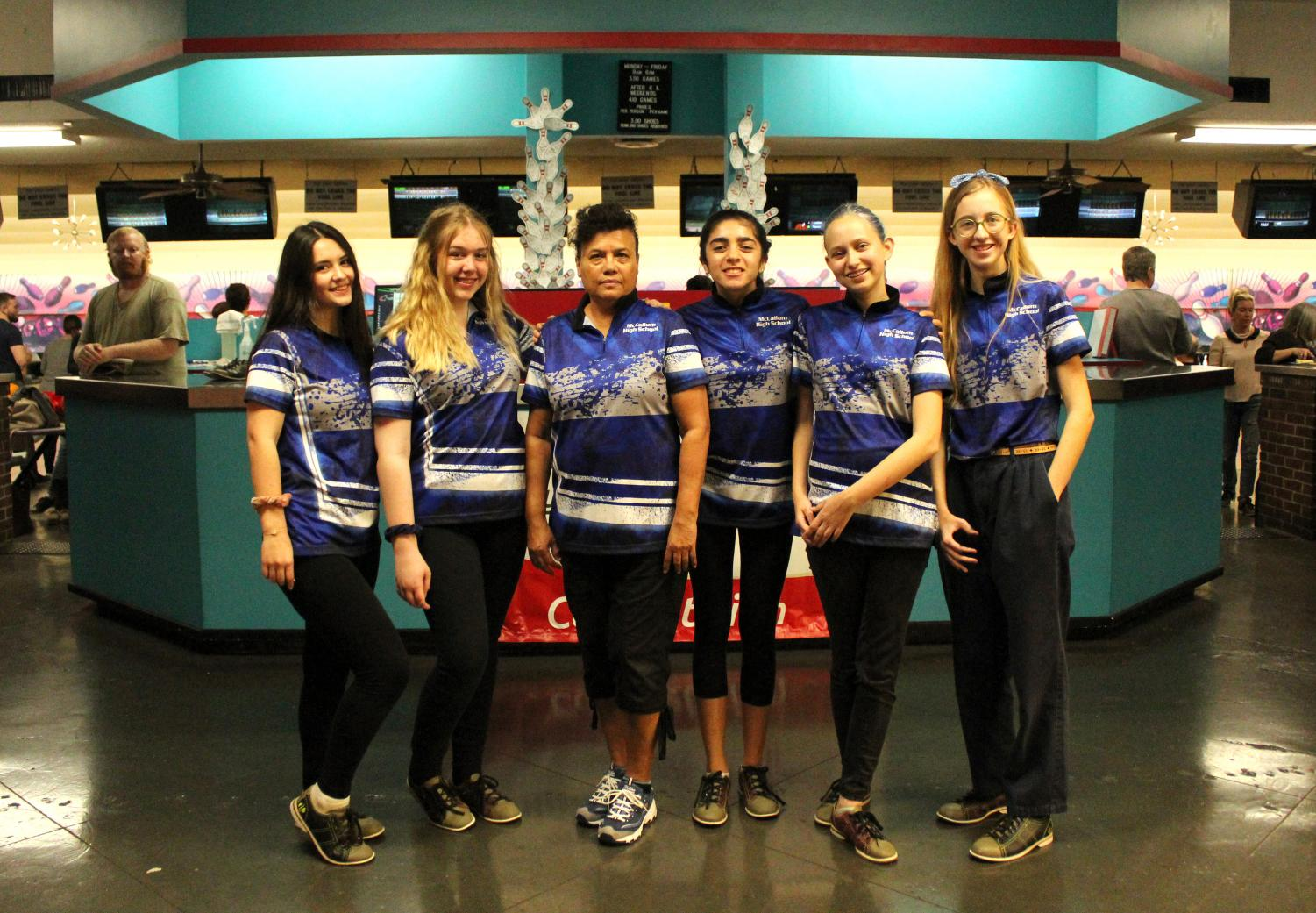 In its first year of competition, the girls bowling team--Rose Dotson, Ivy Golyzniak, Coach Amy Shivers, Frances Arellano, Zoey Rucker and Lulu Elliott--is undefeated in district play  and has only lost one non-district match the entire season. Photo by Carolina Arellano.