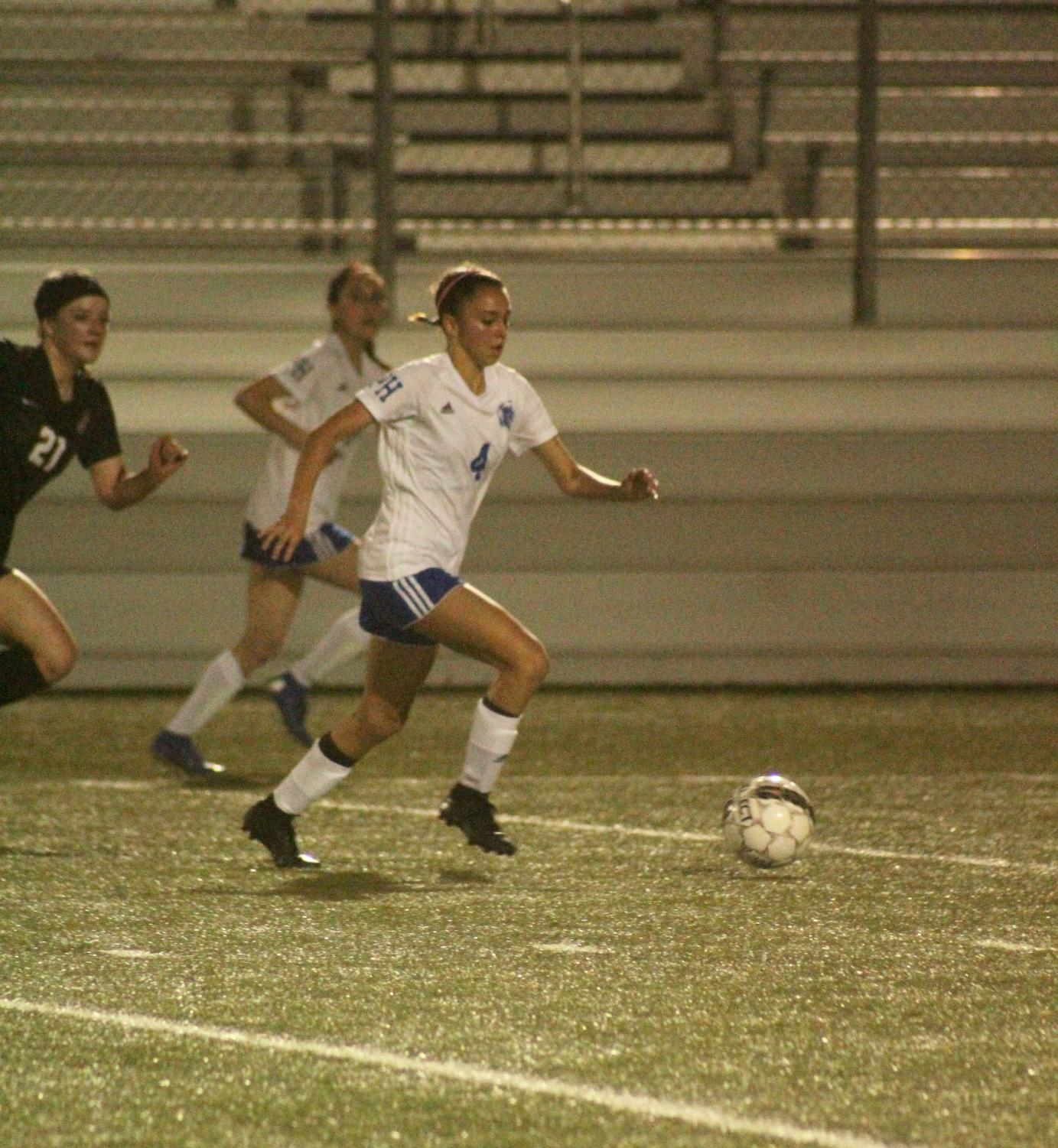 Freshman Mia Gomez rushes downfield followed by a Dripping Springs opponent. Not only did Gomez score for the Lady Knights on a penalty kick, making the total 1-0, but she is the only player in the district with a goal on the Tigers.