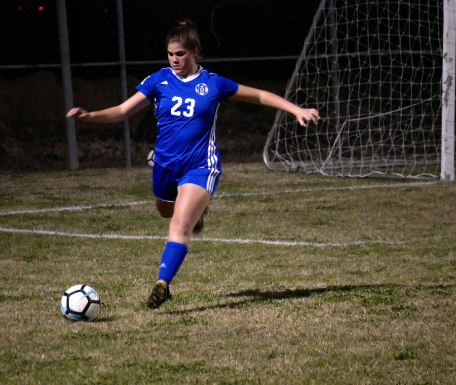 KICKING IT: Stites defends the McCallum goal by kciking the ball downfield on Jan. 19 at Noack field. The varsity girls beat their oppontents 2 to 0 thanks to the goal scoring of freshmen Carly Johnson and Mia Gomez and the strong defense. Photo by Anna Bausman.