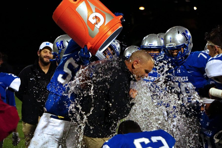 Coach G got a Gatorade shower following the Knights decisive win over Crockett in a game that all but punched the Knights ticket to the playoffs. Photo by Caleb Melville..