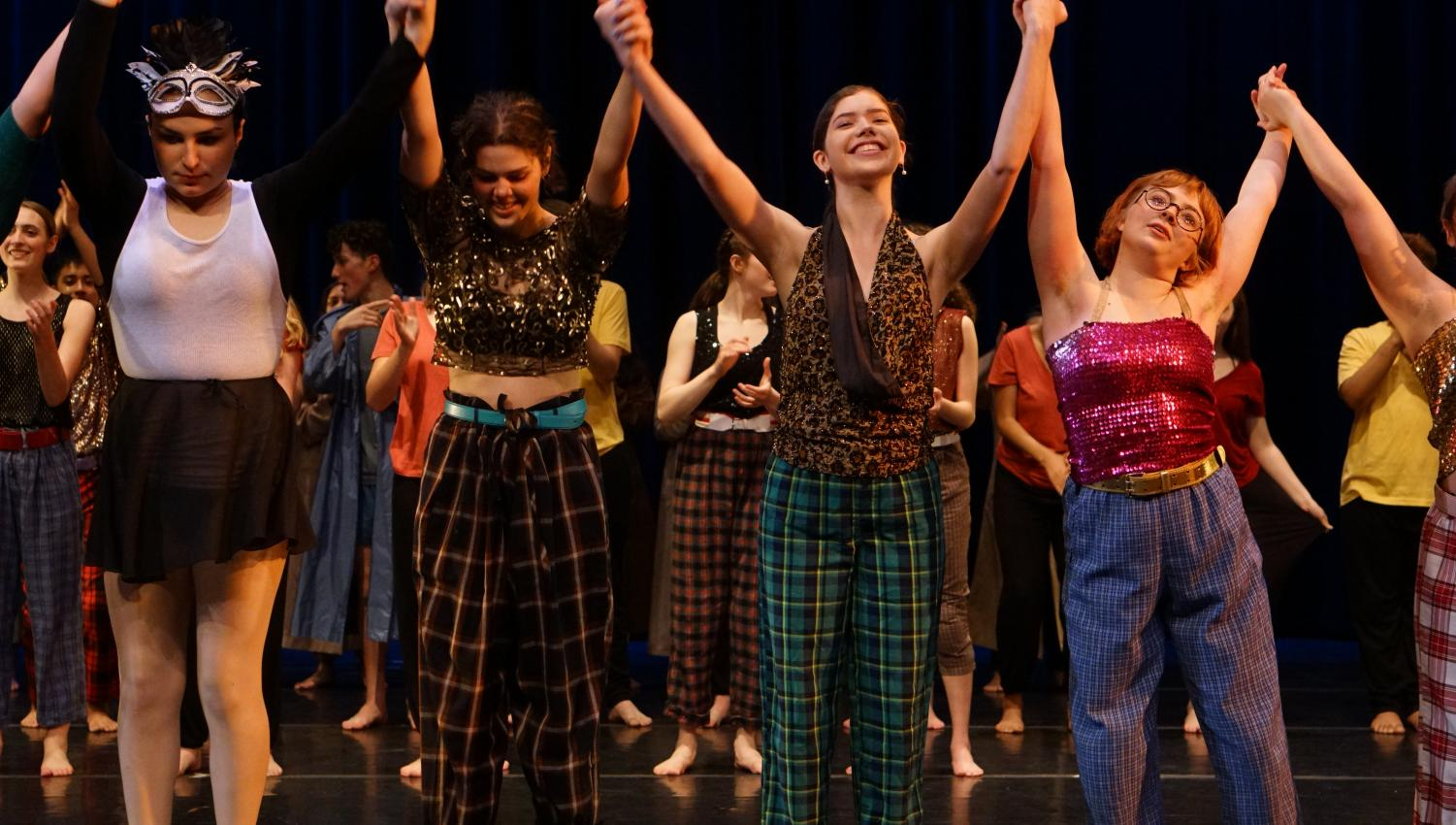 Beatrix Jackman, Anna Marceau, Hannah Hufford and Chloe Shields take their final bows after the Friday night performance of Momentum, the McCallum Youth Dance Company spring concert, at the MAC.