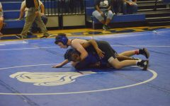 Buford wrestles an opponent during the November scrimmage in the big gym at MAC.