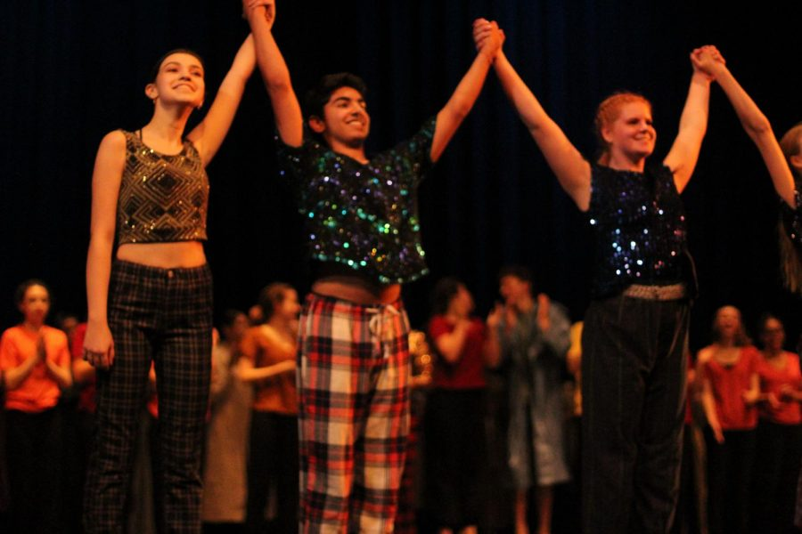 Mia Terminella, Tosh Arora and Lilly Brown take their final bow after the Friday night performance of Momentum, the McCallum Youth Dance Company spring concert, at the MAC.