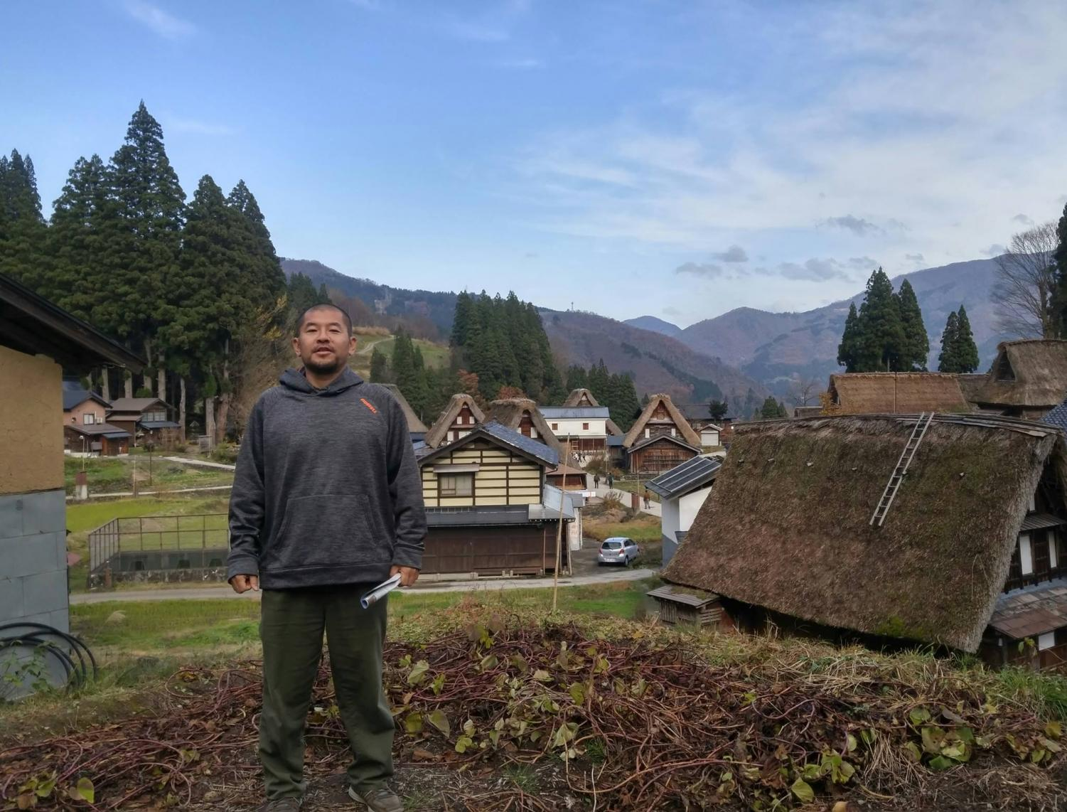 "Japanese teacher Toshio Nishida while in Gokayama, Toyama Prefecture, Japan. Nishida is from Japan and he describes his home country as his happy place. ""It's always really a lot of fun to go there,"" Nishida said. Photo courtesty of Nishida."