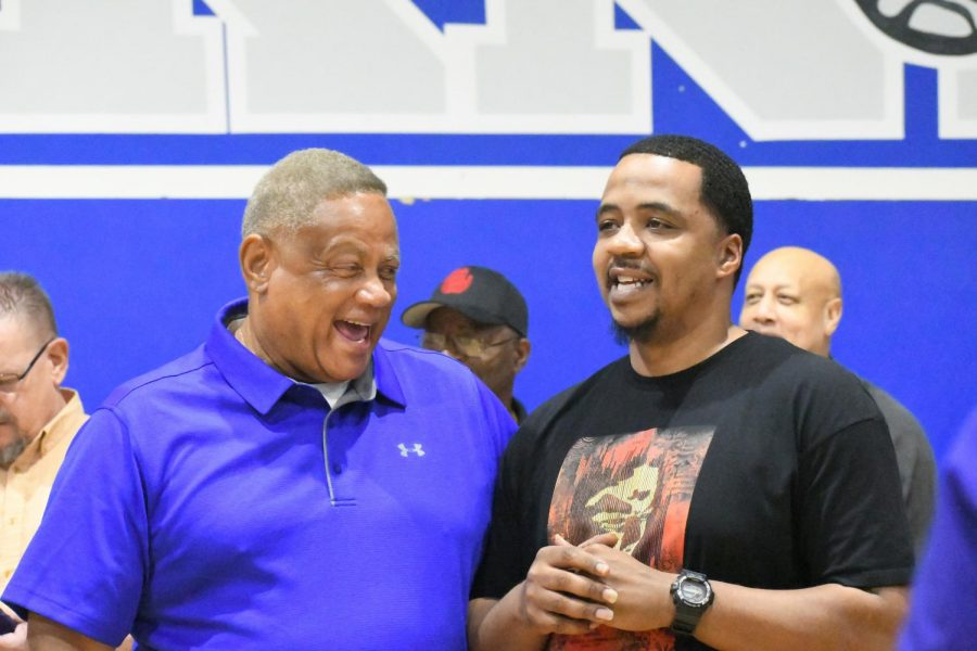 Don Caldwell laughs with former player Damien Mercer, Class of 1992, in the Don Caldwell Gymnasium after it was named in his honor in a surprise ceremony on Nov. 17, 2017. Mercer played on the McCallum team that made the final four under Coach Caldwell.
