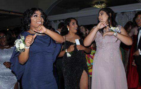 "LIGHTEN UP: Seniors Elesia Zarzoza, Crystal Suarez-Vasquez and Melany Reese dance together to the ""Wobble"" as it got closer to prom king and queen being announced. ""I really liked how everyone was so glammed out and open to having fun,"" Reese said. ""It was a good mood and feeling to be around."" Reporting by Celeste Montes de Oca. Photo by Risa Darlington-Horta."