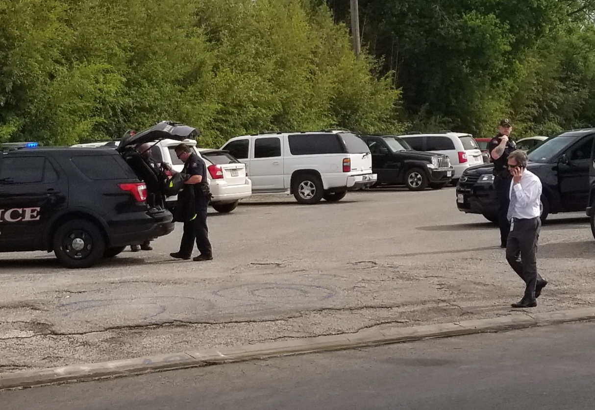 AISD police and school administrators converge on the senior parking lot where the detained main was questioned and later released. He possessed a concealed weapons permit and, according to police, had committed no crime.