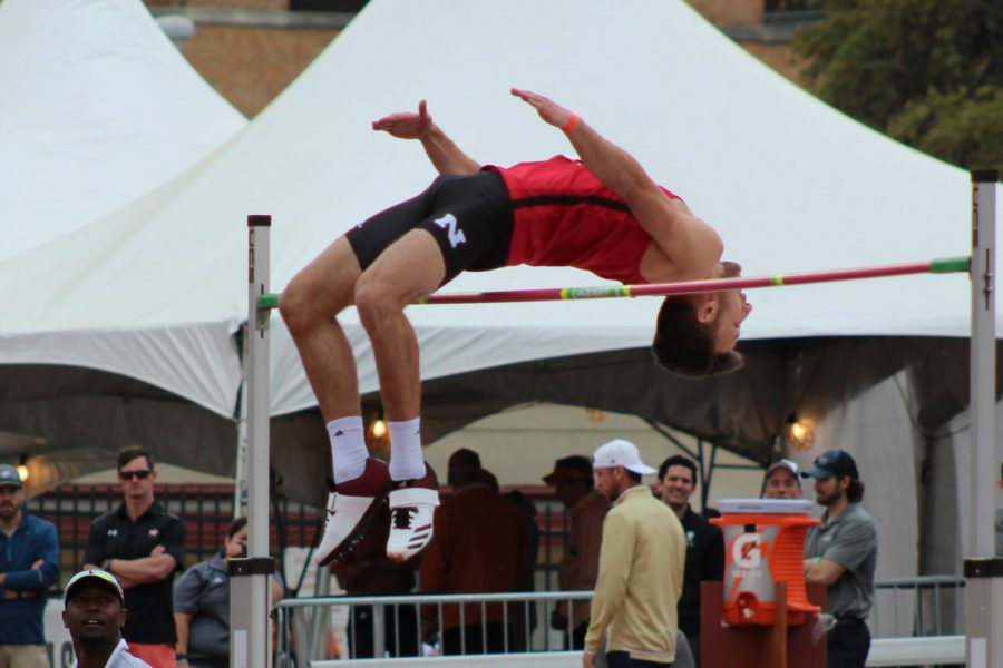 The Texas Relays hosted athletes from several different high schools, colleges, and national level teams. During the college mens high jump, an athlete from Nebraska University clears the pole and moves on to the next height.