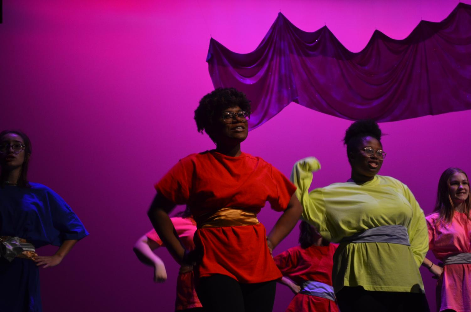 """MEMORIES: In last semester's Cabaret, Foster stands center singing """"My Stongest Suit"""" from Aida the Musical. """"[Cabaret] was really great because that was when I first got to meet so many people... all the different choirs come together to put on a big show,"""" Foster said. Photo by Marley Angle."""