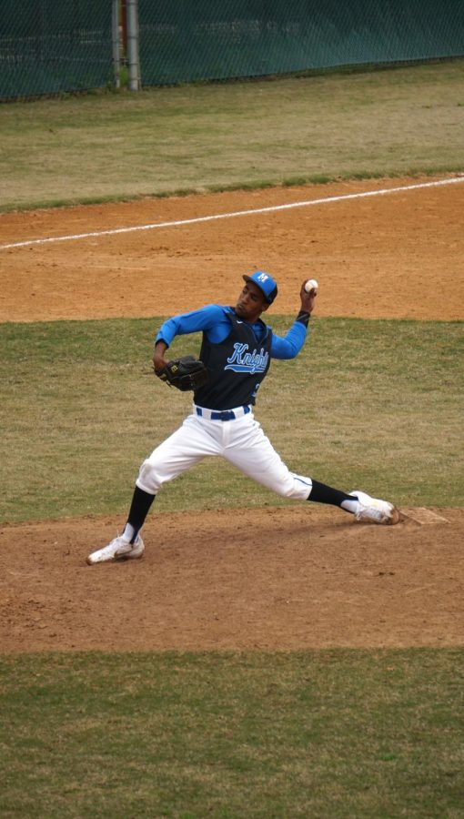 Dietz throws a pitch during the Knights' alumni game, where the varsity beat the alumns 12-10 to start off their season.