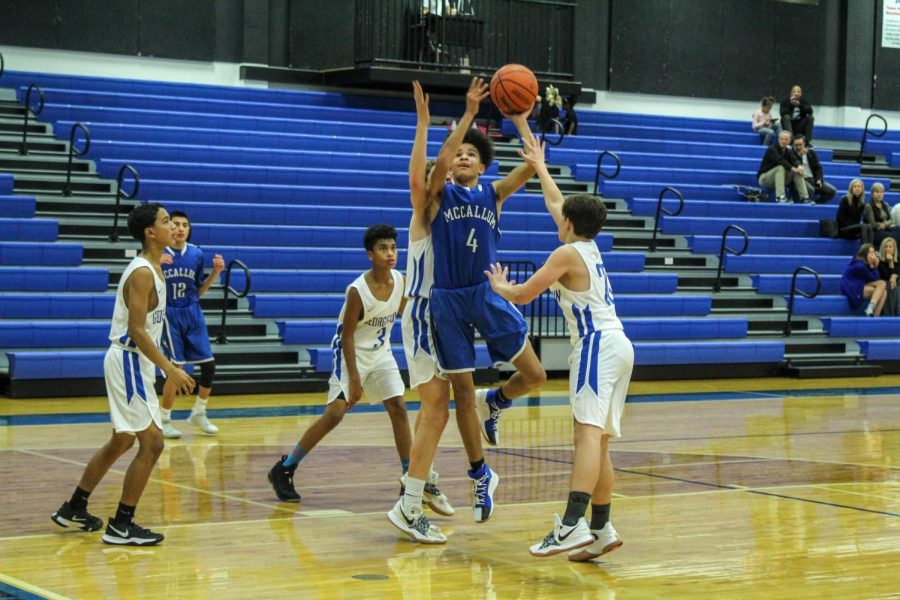 A FROSH START: In his debut in a McCallum uniform, Aiden Wright suited up with the freshman team and scored 16 points in a road victory at Georgetown on Nov. 9. After battling to a one point halftime lead at 31-30, the frosh Knights pulled away in the second half to win by 12, 62-50. Photo by Annabel Winter.