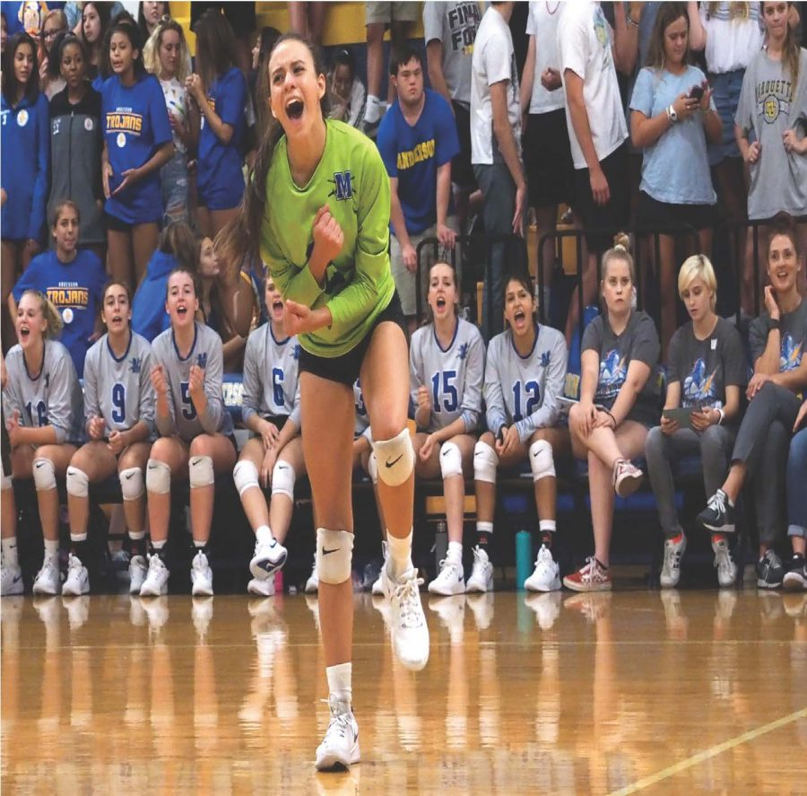 ALL IN AT ANDERSON  Wiley celebrates taking a point in the Lady Knights' 25-20, 25-21, 18-25, 14-25, 15-11 triumph at Anderson on Aug. 24. Because Wiley plays libero, a defensive specialist position, she wears a different colored jersey.  Wiley signed her commitment letter to play college volleyball at Prairie View A&M on April 12.  Photo by Gregory James.