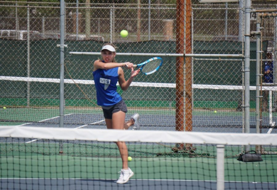 Freshman Peyton Casey hits the ball to her opponents during her and Williams' match against Dripping Springs.