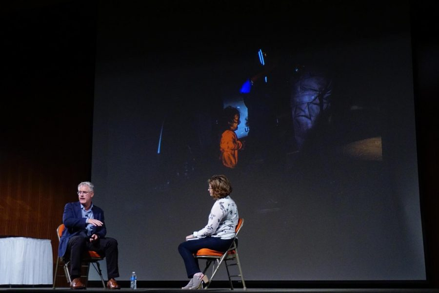 """John Moore's latest accomplishment in the photojournalism world, was winning the 2018 World Press Photo of the Year. His winning picture was part of a series of work on the undocumented crossings at the southern border and showed a young girl crying while her mother is detained by border patrol agents. Recounting the events that transpired, Moore said: """"She [the border patrol agent] said 'Look, you gotta set her down.' and so when she set her daughter down, she immediately started to cry."""" Moore has had some challenges with this photo being taken out of context, even Time Magazine cut out and used part of the photo in a misleading way. The actual story behind the photo is that the family was being taken, together, to a processing center and if they were to be separated was unknown. In his talk, Moore stressed how important it is to have the full story behind a photograph before making assumptions. Photo by Caleb Melville."""