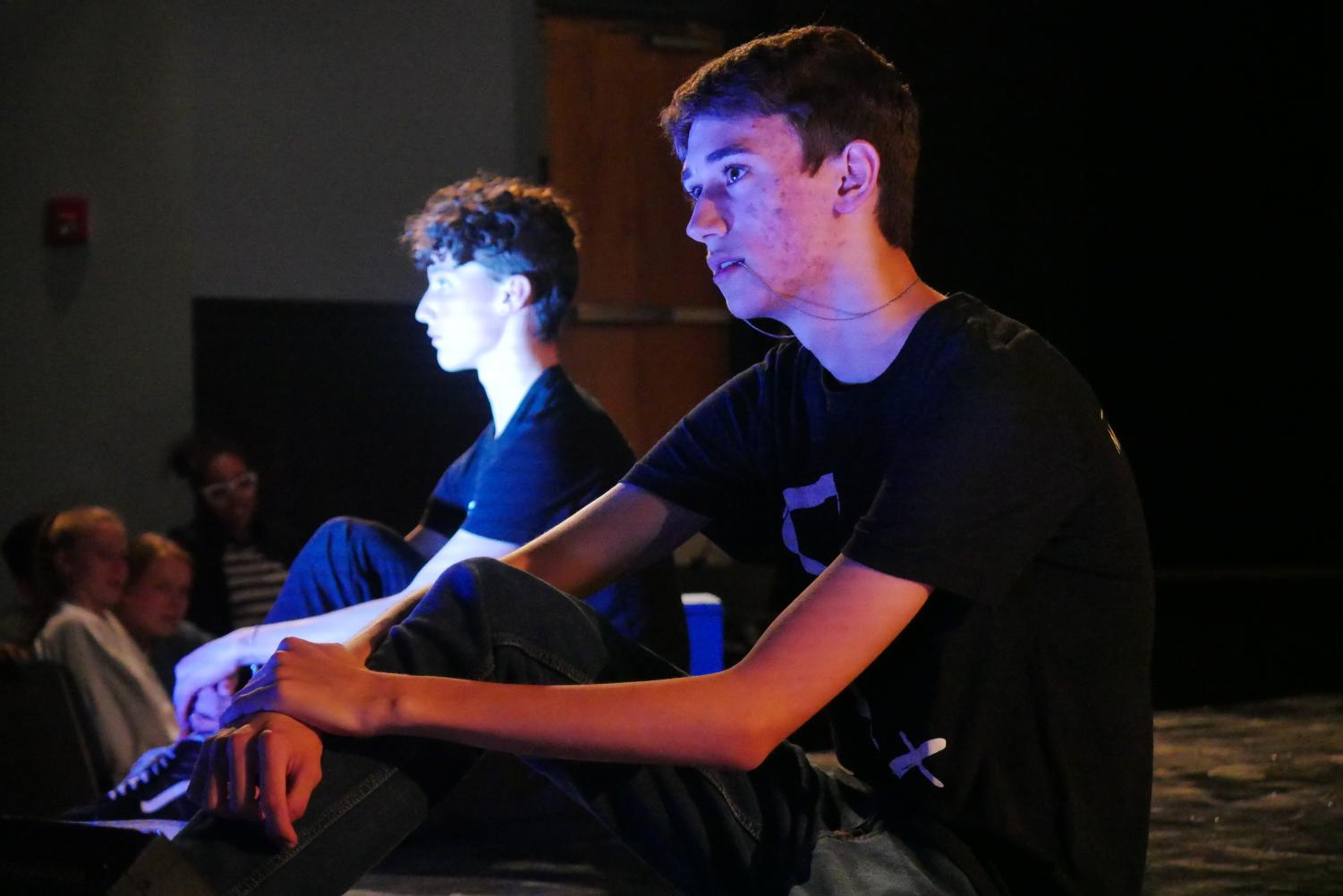 """During the student-directed production of """"My Mother*%^#ing College Life"""" on April 1 in the Fine Arts Building Theater, junior Edward Fotinos and sophomore Aydan Howison sit silently onstage while sophomore Dashel Beckett delivers a monologue behind them.  Photos by Stella Shenkman."""