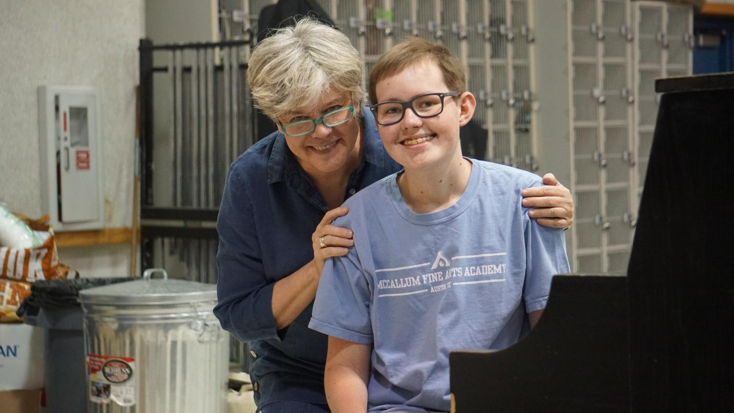 "MORE THAN A TEACHER: The dynamic duo of band director Carol Nelson and senior Townes Hobratschk smile together in the band hall. The two have been through a lot over his four years at McCallum, and as Townes finishes his senior year, it is evident that they have shaped each other's lives in many ways. When Townes was diagnosed with brain cancer. Nelson brought a tuba to the hospital so he could stay connected with the band, and despite his diagnosis, she encouraged Townes to make the band's trip that summer to Carnegie Hall.  ""She believed in me, and because of that, I had one of the best experiences of my life,"