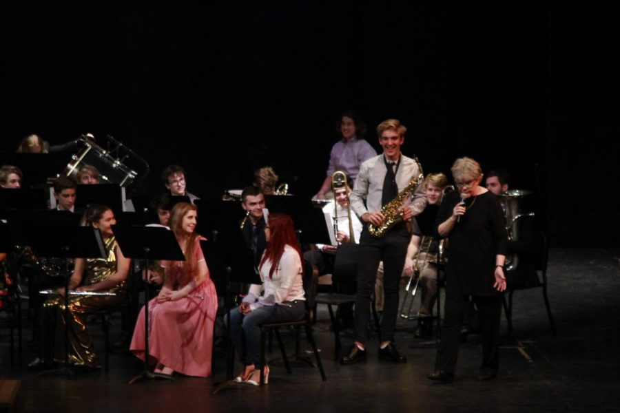 At Wednesday's spring band concert in the MAC, band director Carol Nelson recognized saxophone player, French foreign exchange student and freshman Nelson Vilbert. Photo by Scarlett Houser.