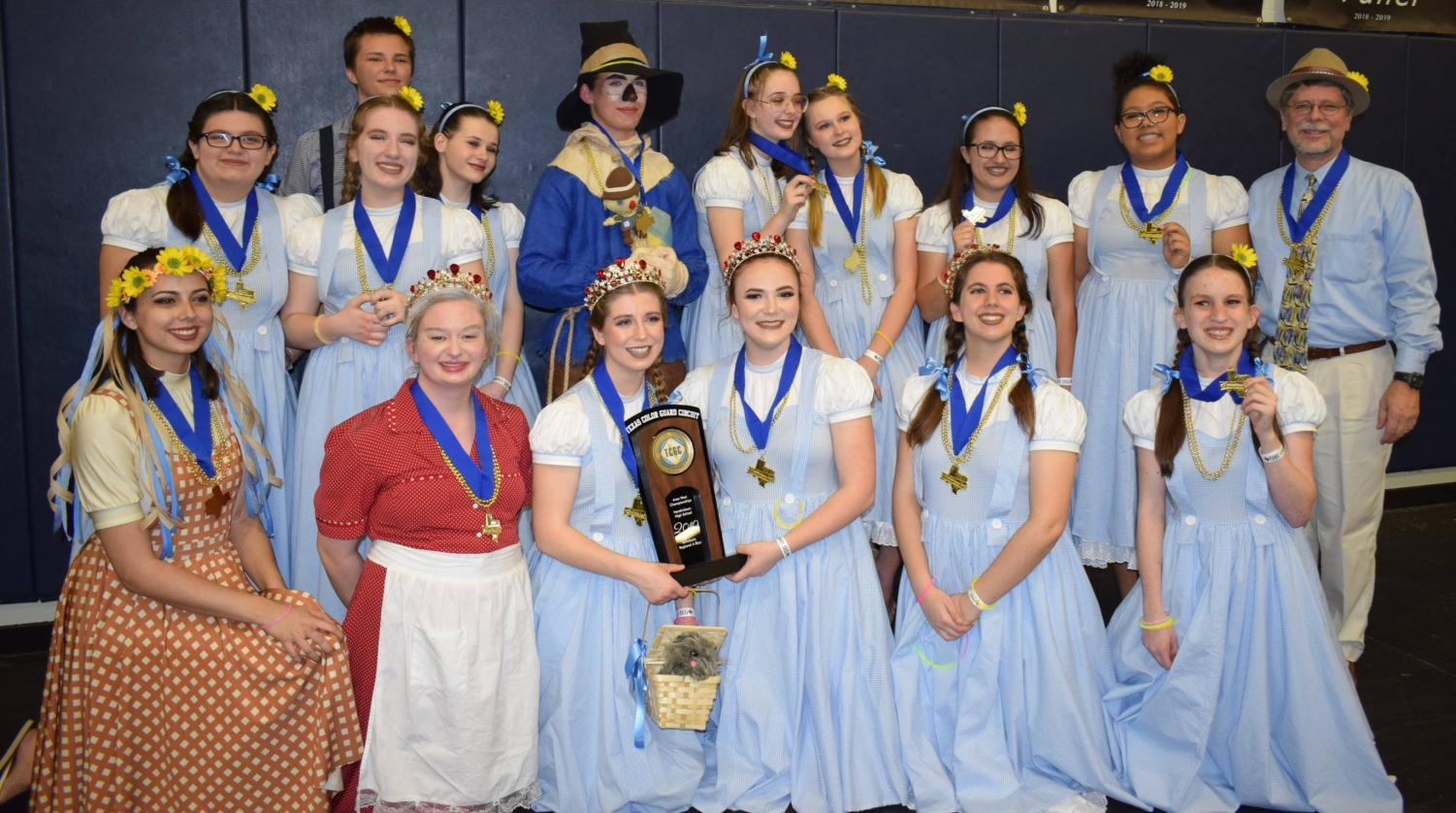 "The guard poses after they had finished their show and placed first for their competition, with the highest score in the state. ""I knew we were going to do well,"" director Jeff Rudy said. ""I thought we had a really good chance of winning, but there is never any guarantee."""