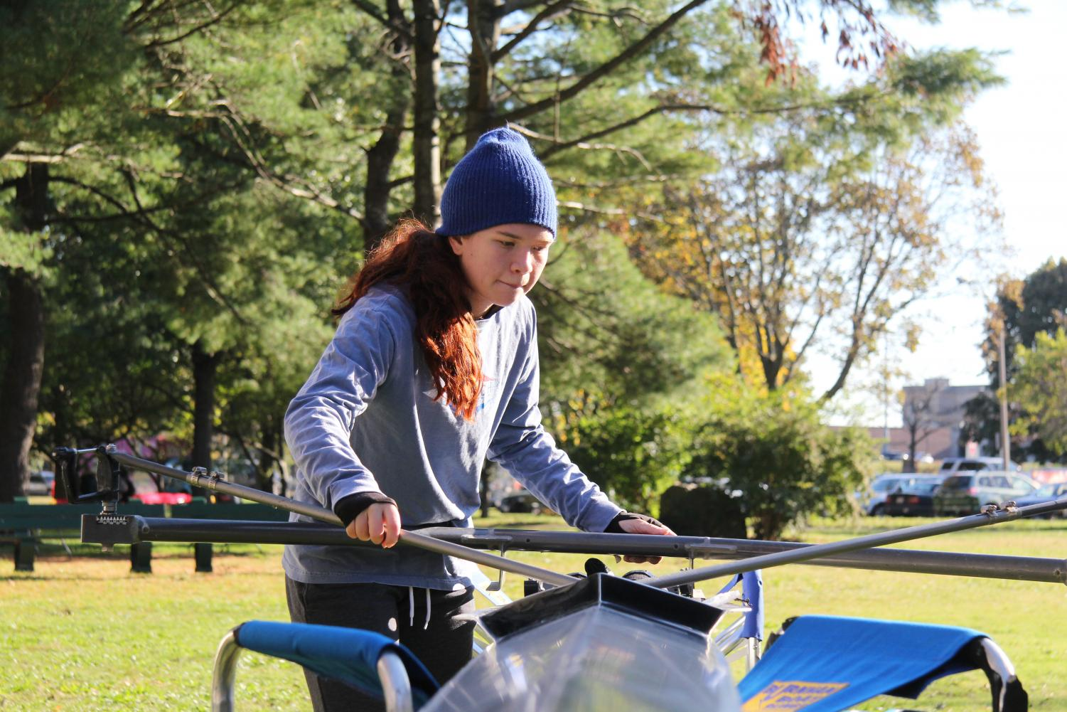 Myren begins to rig her single at the Head of the Charles regatta last October.