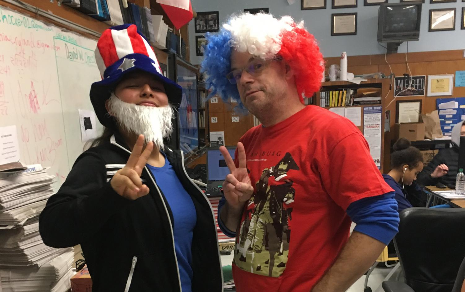 In a rare moment in front of the camera, freshman Selena De Jesus dons  the Uncle Sam gear to celebrate Amercia Day with photojournalism teacher Dave Winter. Photo by Anna Bausman.