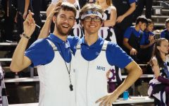 """BAND BUDDIES: Senior Jonathan Forbes and junior Dexter Canning pose at the annual Battle of the Bell football game, in which McCallum defeated Travis, 72-0, at Burger Stadium on Oct. 26. The pair has been playing in marching band together since their time attending Fulmore Middle School. """"Jon is more dedicated to music than anyone I know, whether it be random facts, or just how to be better."""" Canning said. Photo by Gregory James."""