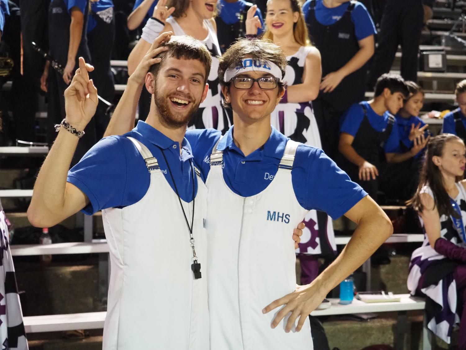 "BAND BUDDIES: Senior Jonathan Forbes and junior Dexter Canning pose at the annual Battle of the Bell football game, in which McCallum defeated Travis, 72-0, at Burger Stadium on Oct. 26. The pair has been playing in marching band together since their time attending Fulmore Middle School. ""Jon is more dedicated to music than anyone I know, whether it be random facts, or just how to be better."" Canning said. Photo by Gregory James."
