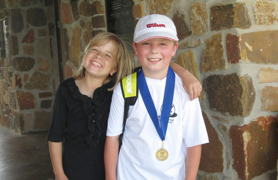 "An 11-year-old Steven Tibbetts smiles with his sister after winning a Zonal Advancement Tournament in May of 2012. The victory allowed him to move up to the ""Champ"" level in the 12-and-under division. Currently, Tibbetts is at the ""Super Champ"" level in the 18-and-under division. Photo by Anne Tibbetts."