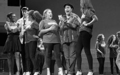 AISD summer theatre series preview event is black and white (photos) and red (carpet) all over