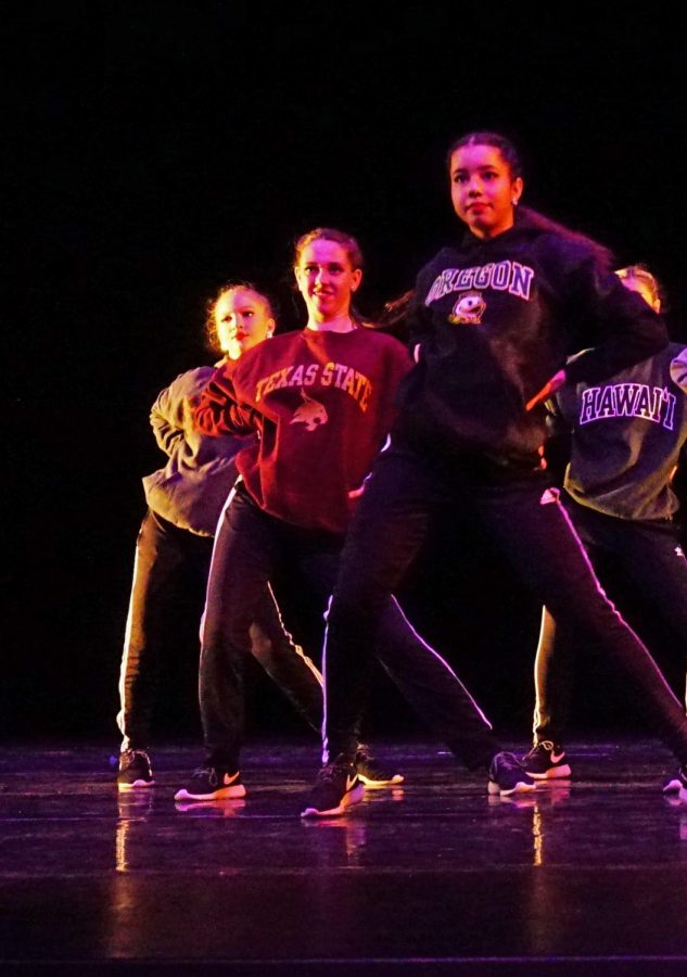 Along with fellow Blue Brigade seniors Jane Addison lle and Chanyn James, Sophia Salo proudly displayed her college intentions during a special seniors performance at the spring dance show on Aug. 13.