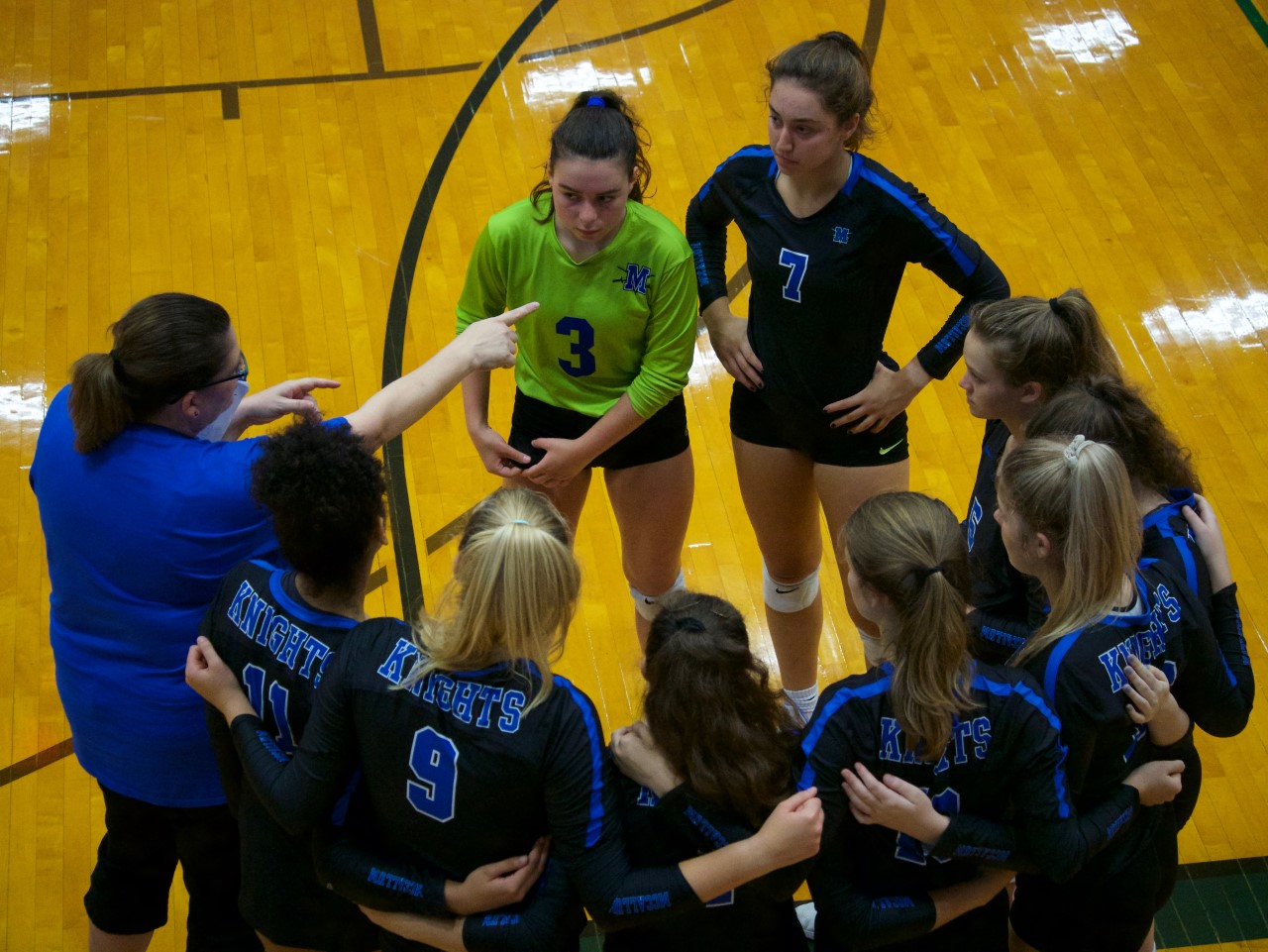 Head coach Amy Brodbeck instructs her team during a break in the action against arch-rival Anderson.  The Knights played the Trojans tough, but lost in two tightly contested sets, 25-23, 25-23.