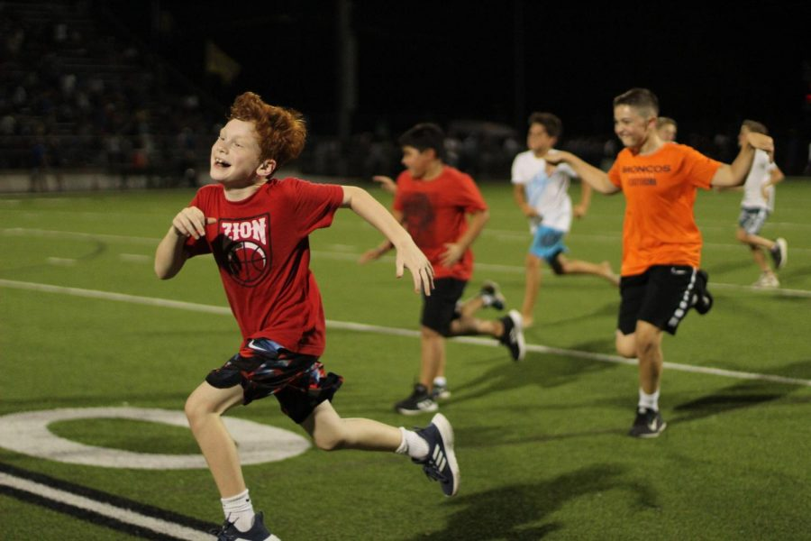 Kids run the length of the field near the end of halftime ceremonies at the 2019 Taco Shack Bowl at House Park last Thursday.