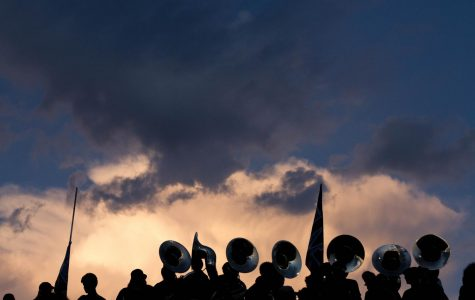 The McCallum Marching Band is silhouetted against the twilight Austin sky above House Park just moments before the opening kickoff of the 2019 Taco Shack Bowl last Thursday.