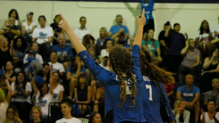 Junior setter Sophia Henderson raises her arms in triumph after the Knights win a key point during their four-set road victory over arch-rival LBJ on Friday.