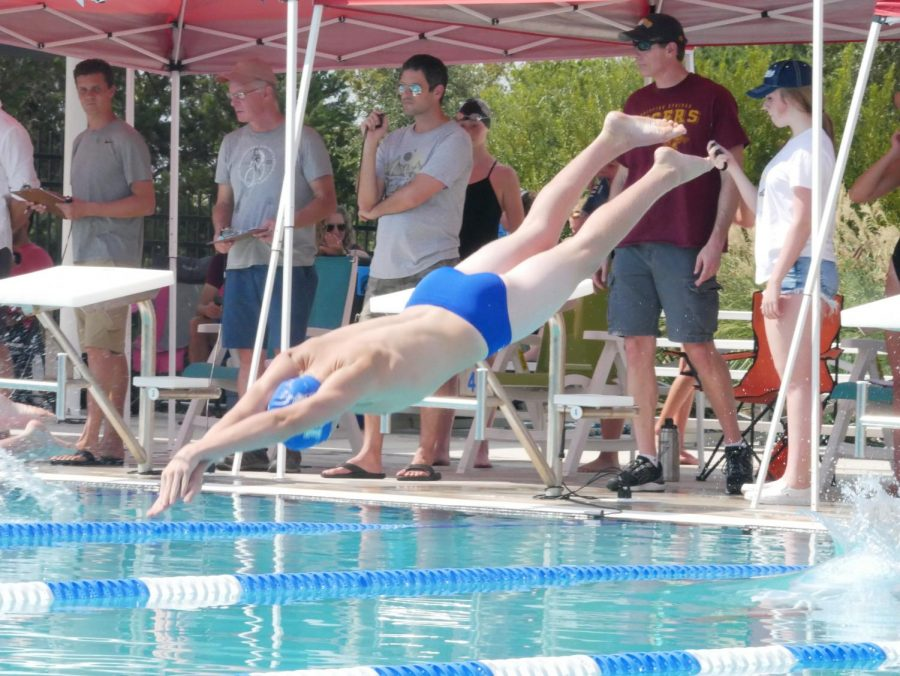 "DIVING UP: Zaplatar dives into the water at the Dripping Springs Swim meet on Sept. 14.  In the first meet of the season, Zaplatar finished first in both the 50-meter and 100-meter breaststroke.  His teammates and fellow competitors from other high schools congratulated him on his wins. ""I really want to drop my time,"" Zaplatar said, ""but also, I [want] to make a better connection with the rest of the team."""
