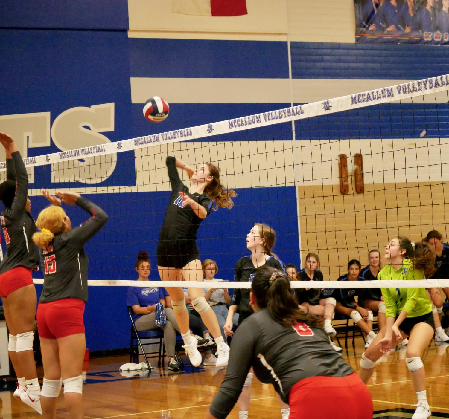Junior outside hitter Sarah Weisbrodt leaps up for a kill against Travis on Friday, Sept. 27. After defeating the Rebels, the Knights have a 5-0 conference winning record, as does Dripping Springs, their opponent for Tuesday night's match.