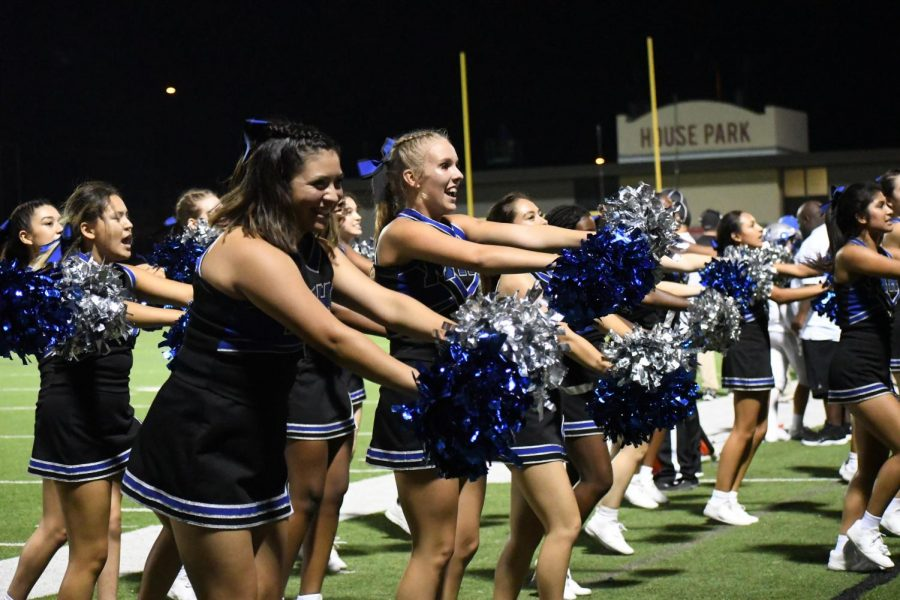 SOMETHING TO CHEER ABOUT: The cheer squad reacts to Takai Satberry's fourth-quarter touchdown reception by conducting a cheer for the Mac student section on the visiting side of House Park. Olivia Navarro, a junior cheerleader at McCallum, said that that she