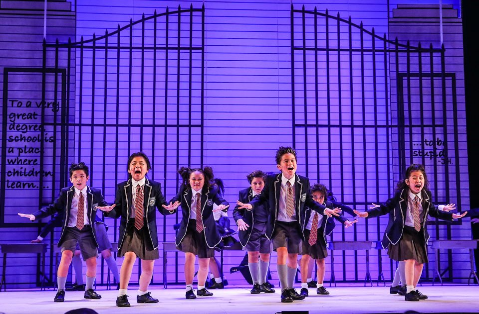 "REVOLTING CHILDREN: At the end of the musical Matilda, the school children ""revolt"" against the evil rule of their headmistress, Miss Trunchbull. This results in a large. extravegant dance number, which Uehara states was definetly one of her favorite to choreograph. Uehara said that the young dancers expressed a joy of learning that was wonderful for her to witness. Photo by Brad Mondo."