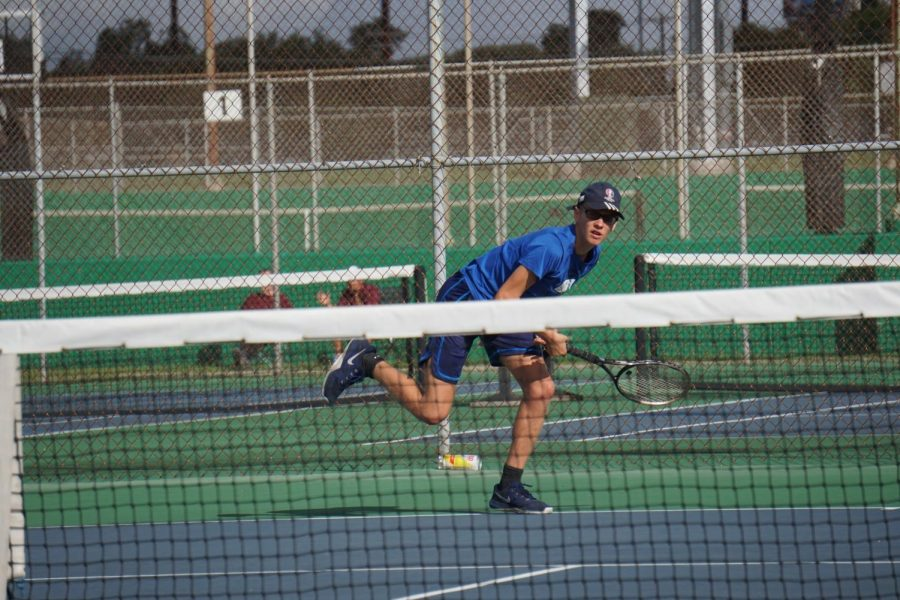 Senior Wyeth Purkiss follows through following a return to his Crockett opponent during his singles match. He won, 6-2, 6-3, his second win against this opposing team. Purkiss and junior Marley Gattis took the loss, 6-1, 6-2, against Lockhart the next day. Photo by Elisha Scott.