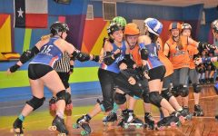 Henson (left) and Stauffer (center) team up during the Texas Junior Roller Derby's victory over Rolling Rebellion Roller Derby on May 5 at Skate Country in Bellemead, Texas. The victory helped TXJRD to a 14th place finish nationally last season. The team is playing a non-competitive season this fall.