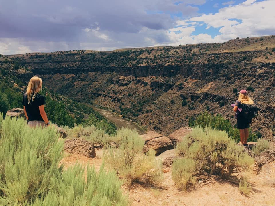 SCENIC SERENITY: Zach Steiner, right, and his Lama Foundation colleague Aaron (left) overlook the Rio Grande hot springs, which is located a short drive away from the foundation in Taos, New Mexico. Photo courtesy of Steiner.