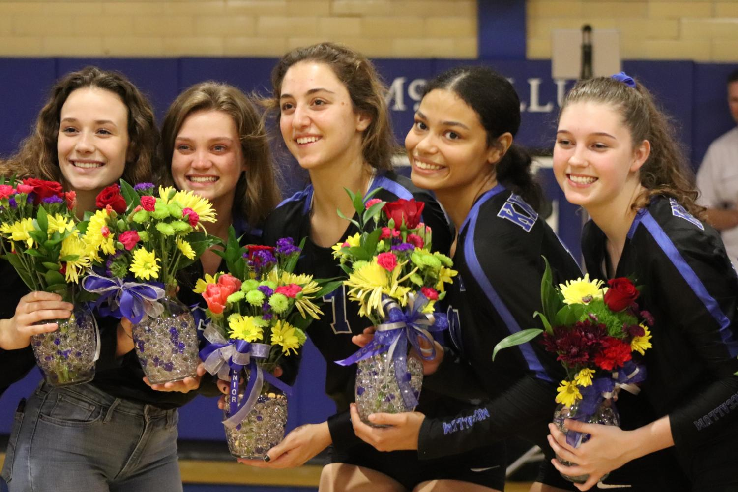 Fannin (fourth from left) and her senior teammates receive flowers at the Senior Night game against Dripping Springs. Photo by Gabby Sherwood.