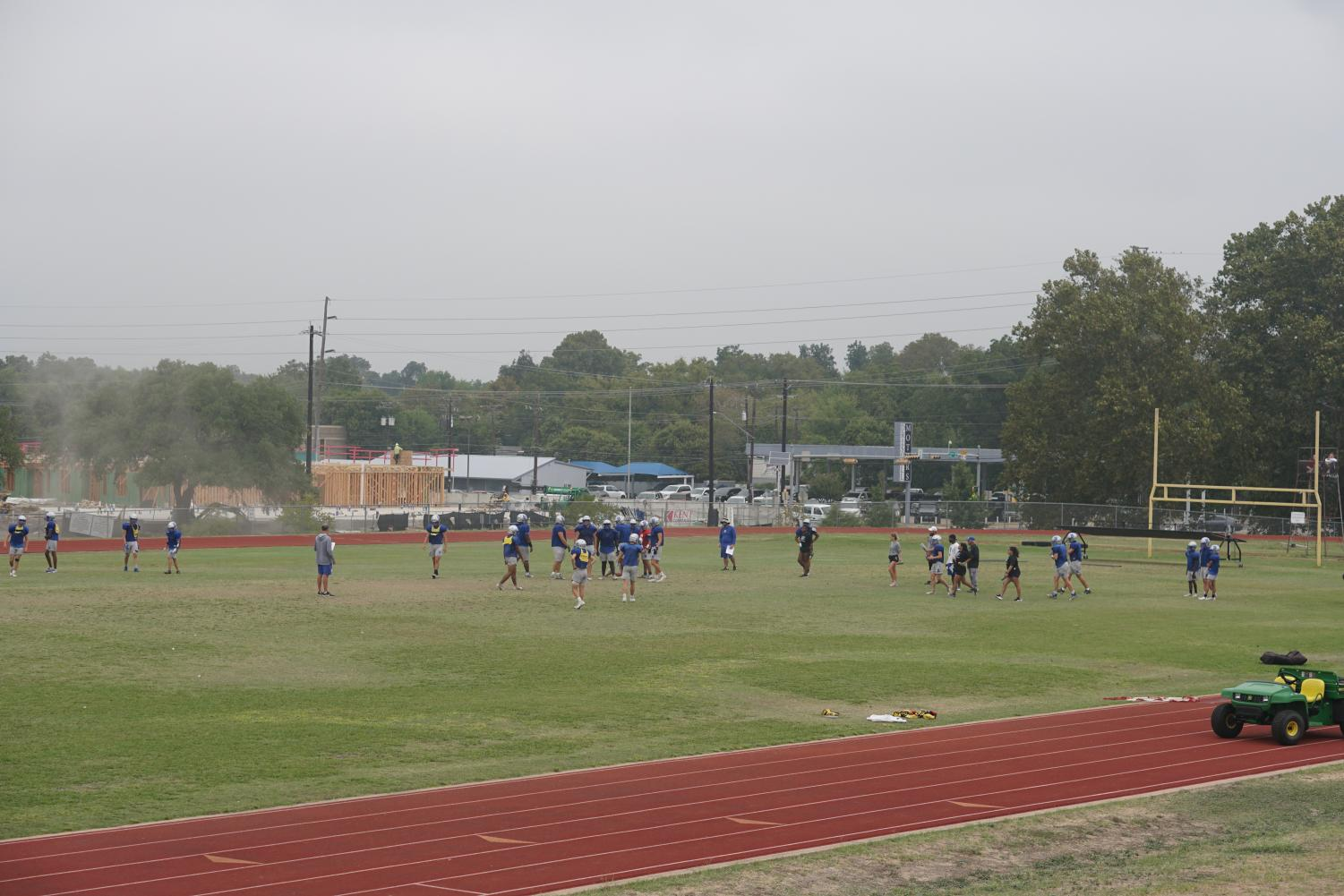 KNIGHTS BEFORE NINE. The varsity football teams practices before school and then again during the double-blocked first and fifth periods.  Only junior varsity and varsity practice on the big field, but the freshmen practice on the auxiliary field. Photo by Grace Nugent.