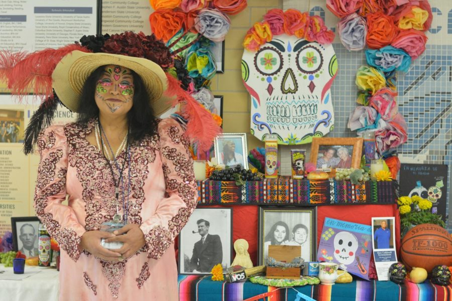 REVISITING VIERNES: Spanish teachers celebrated Day of the Dead on campus in a couple of ways on Friday. Señora Gun came dressed for the occasion and stopped by 134 for a MacJournalism portrait session by the Day of the Dead altar in the main hallway. Gun offered a big shout out to Mrs. Rios Tiessen and Mr. Seckar Martinez and the art students for the beautiful altar! Photo by Alex Dowd.