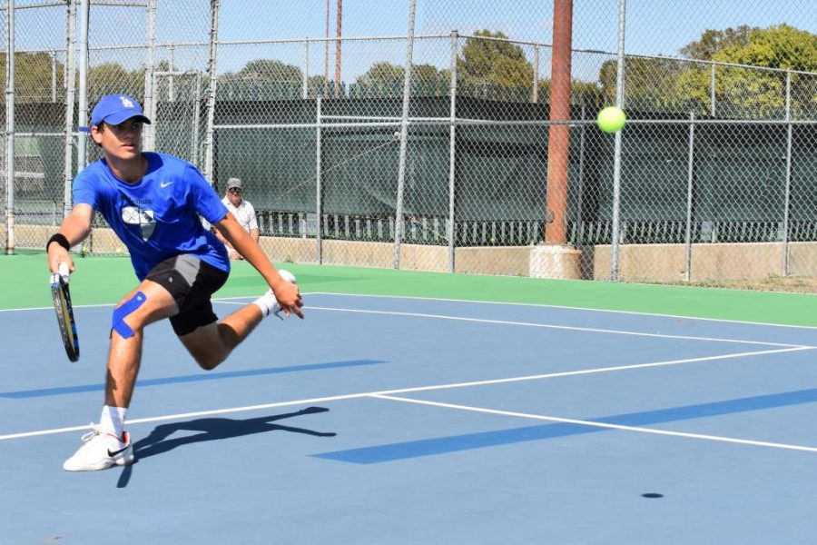 Sophomore Micheal Alverson competes at the 2019 District tennis meet on Oct. 1. Photo by Esme Moreno-Bernacki.