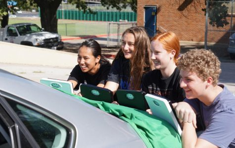"AP PHYSICS, A WEIGHTY SUBJECT: Juniors Hannah Zuniga, Lindsey Plotkin, Darian Dieterich and Tres Tanner complete a hands-on lab, in which the task was to use the skills they'd learned in trigonometry to solve for the mass of the car. ""The lab was really interesting,"" Tanner said. ""Physics is a fun class; I will be taking the AP test."" Photo by Bella Kisler."