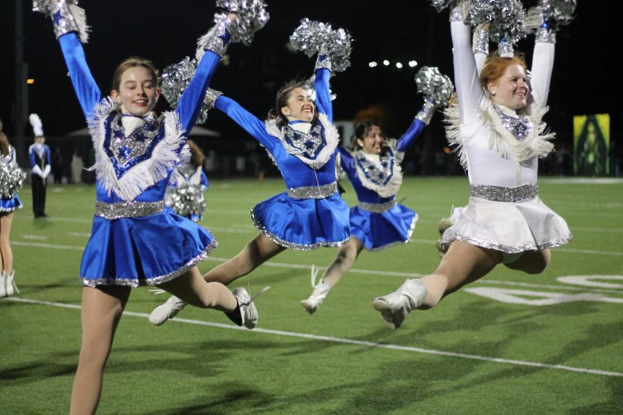 Blue Brigade members Harper Cummings and Lily Brown perform at the football game against Travis at House Park. Photo by Caleb Melville.